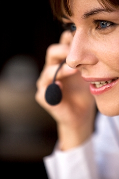 Image of a female employee answering the telephone.
