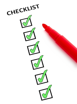 Image of a red pen filling in a checklist with six green ticks.
