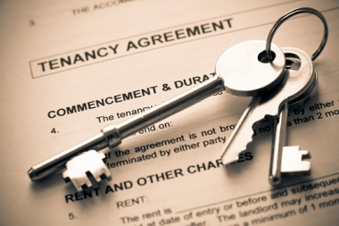 Image of a Tenancy Agreement with a set of keys.